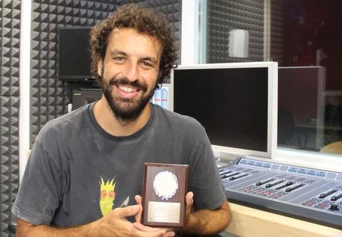 Yiannis Christidis with his award at CUT Radio in Cyprus