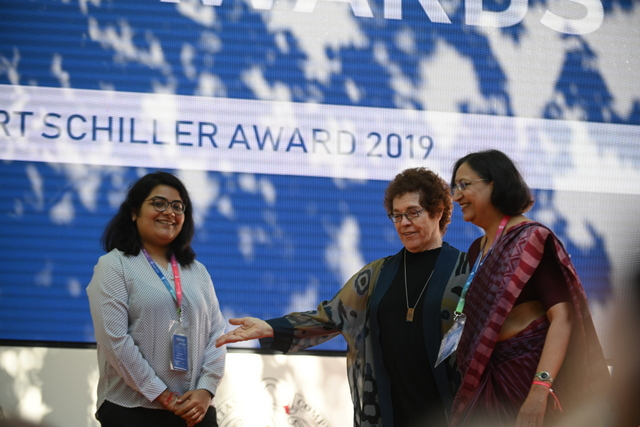 Pooja Ichplani (L) and Archna Kumar received the award from Janet Wasko